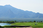 The Santa Rita Mountains of the Coronado National Forest in the Sonoran Desert serve as a backdrop for the Canoa Ranch Golf Club in Green Valley, Arizona, USA.
