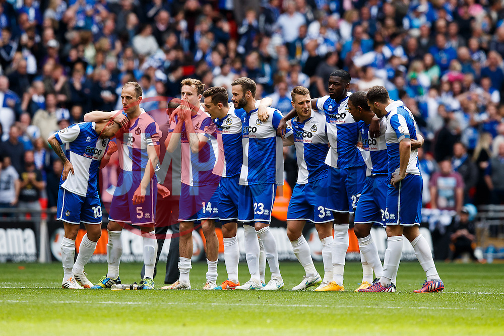 Bristol Rovers players look on nervously during the penalty shootout - Photo mandatory by-line: Rogan Thomson/JMP - 07966 386802 - 17/05/2015 - SPORT - FOOTBALL - London, England - Wembley Stadium - Bristol Rovers v Frimsby Town - Vanarama Conference Premier Play-off Final.