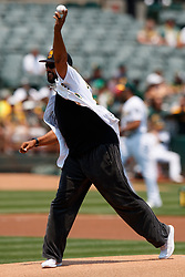 OAKLAND, CA - JULY 01:  Former Oakland Athletics outfielder David Justice throws out the ceremonial first pitch before the game against the Cleveland Indians at the Oakland Coliseum on July 1, 2018 in Oakland, California. The Cleveland Indians defeated the Oakland Athletics 15-3. (Photo by Jason O. Watson/Getty Images) *** Local Caption *** David Justice