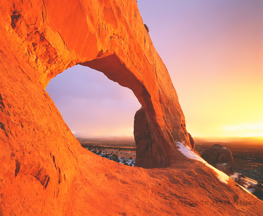 0352-1025 ~ Copyright: George H. H. Huey ~ Wilson Arch at sunset with winter storm.  BLM. Southeast Utah.