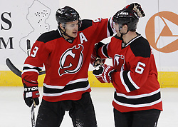 Jan 22, 2010; Newark, NJ, USA; New Jersey Devils left wing Zach Parise (9) celebrates his goal with New Jersey Devils defenseman Andy Greene (6) during the first period at the Prudential Center.