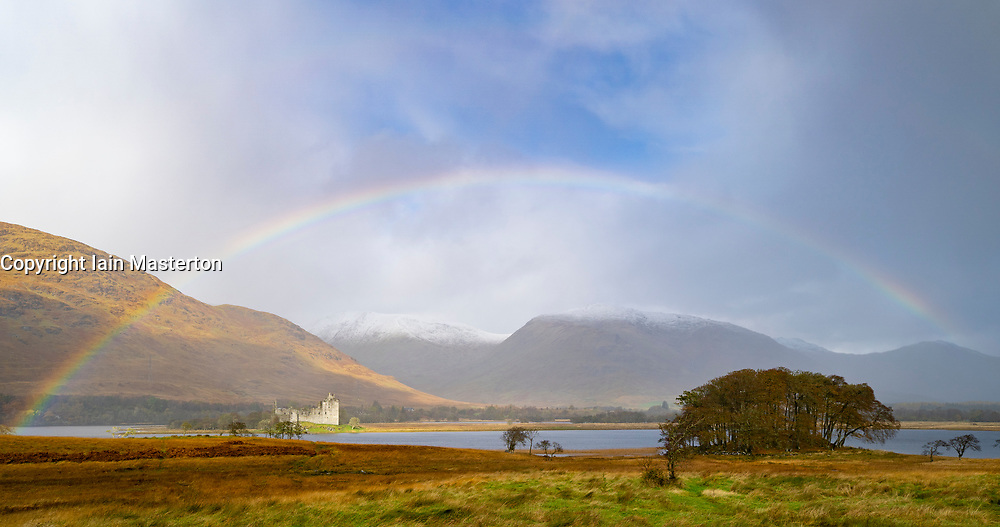 26October 2019. Full rainbow appears over Kilchurn castle at Dalmally in Argyll and But in west of Scotland