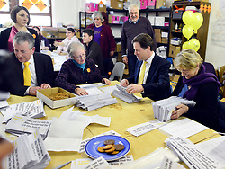 © Licensed to London News Pictures. 27/02/2013. Eastleigh, UK. Leader of the Liberal Democrats and Deputy Prime minister Nick Clegg (right) and Liberal Democrat Parliamentary Candidate for Eastleigh, Mike Thornton help pack campaign leaflets at the Liberal Democrat campaign headquarters in Eastleigh today 27th February 2013. Polling takes place across the borough tomorrow.  Photo credit : Stephen Simpson/LNP