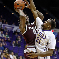 Feb 4, 2017; Baton Rouge, LA, USA; Texas A&M Aggies forward Robert Williams (44) shoots over LSU Tigers forward Aaron Epps (21) during the second half at the Pete Maravich Assembly Center. Texas A&M defeated LSU 85-73. Mandatory Credit: Derick E. Hingle-USA TODAY Sports