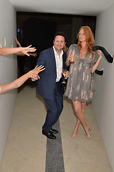Olivia Inge and Peter Davies at the Veuve Clicquot Widow Series launch party curated by Carine Roitfeld and CR Studio held at Islington Green, London England. 19 October 2017.