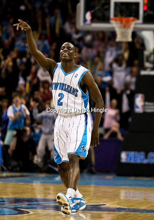 Feb 26, 2010; New Orleans, LA, USA; New Orleans Hornets guard Darren Collison (2) celebrates after a three point basket against the Orlando Magic during the second half at the New Orleans Arena. The Hornets defeated the Magic 100-93. Mandatory Credit: Derick E. Hingle-US PRESSWIRE