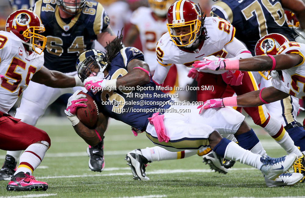 Oct. 2, 2011 - St. Louis, MO, USA - St. Louis Rams' Steven Jackson is taken down by Washington Redskins' London Fletcher, left, Kevin Barnes, center, and Rocky McIntosh after a run in the second quarter at Edward Jones Dome in St. Louis, Missouri, Sunday, October 2, 2011
