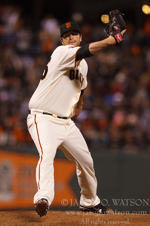 September 12, 2011; San Francisco, CA, USA;  San Francisco Giants relief pitcher Dan Runzler (45) pitches against the San Diego Padres during the sixth inning at AT&T Park.