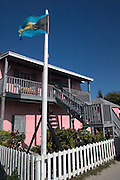 The flag of the Bahamas flies over the Bimini Museum along the King's Highway in Alice Town on the tiny Caribbean island of Bimini, Bahamas