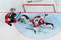 Sean Couturier of Canada vs Ondrej Pavelec of Czech Republic during Ice Hockey match between Canada and Czech Republic at Semifinals of 2015 IIHF World Championship, on May 16, 2015 in O2 Arena, Prague, Czech Republic. Photo by Vid Ponikvar / Sportida