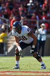 PALO ALTO, CA - OCTOBER 06: Offensive linesman Mickey Baucus #68 of the Arizona Wildcats lines up for a play against the Stanford Cardinal during the fourth quarter at Stanford Stadium on October 6, 2012 in Palo Alto, California. The Stanford Cardinal defeated the Arizona Wildcats 54-48 in overtime. (Photo by Jason O. Watson/Getty Images) *** Local Caption *** Mickey Baucus