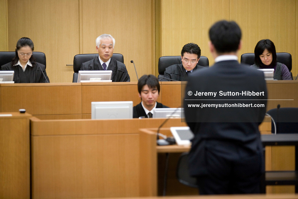 "The three judges and six 'lay judges' ( members of the public forming the jury) preside over courtroom proceedings during a mock trial where the defendant was accused of ""accidental mortality"" (and found innocent), in Saitama District Court, in Urawa town, Saitama city, Japan, Friday 27th February 2009. The mock trial is part of the process of introducing the 'lay judges jury system' to the Japanese law system. Trials with 'lay judge juries' will begin in May 2009."