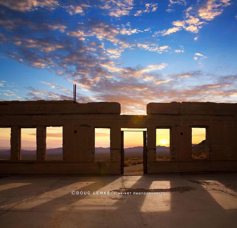 Sunset Through The Windows Of A Roofless And Crumbling Building Overlooking The Amargosa Valley At Rhyolite Nevada, An Abandoned Town Near Death Valley, USA