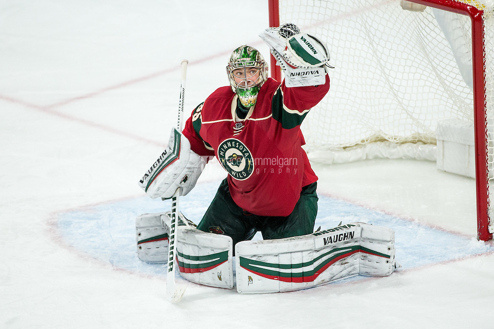 Dec 17, 2016; Saint Paul, MN, USA; Minnesota Wild goalie Darcy Kuemper (35) makes a save during the third period against the Arizona Coyotes at Xcel Energy Center. The Wild defeated the Coyotes 4-1. Mandatory Credit: Brace Hemmelgarn-USA TODAY Sports