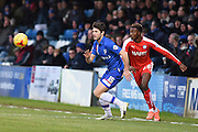 Gillingham defender Aaron Morris and Chesterfield midfielder Gboly Ariyibi during the Sky Bet League 1 match between Gillingham and Chesterfield at the MEMS Priestfield Stadium, Gillingham, England on 27 February 2016. Photo by Martin Cole.
