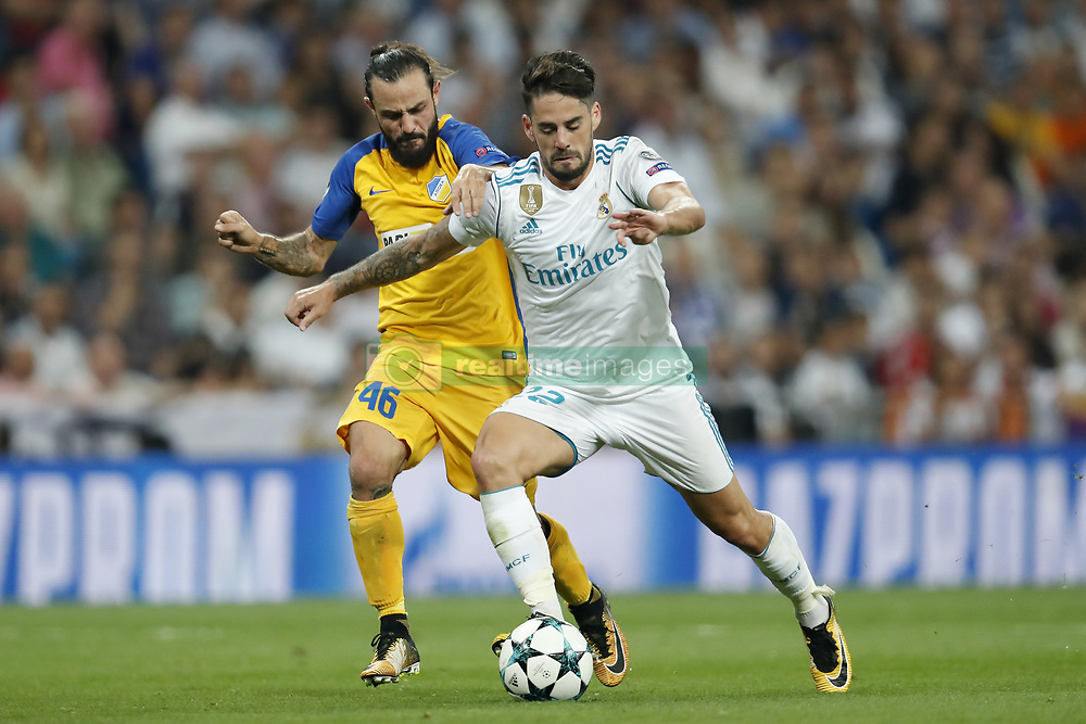 (L-R) Stathis Aloneftis of APOEL FC, Isco of Real Madrid during the UEFA Champions League group H match between Real Madrid and APOEL FC on September 13, 2017 at the Santiago Bernabeu stadium in Madrid, Spain.