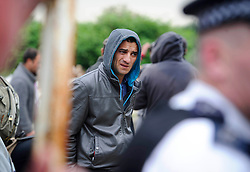 © Licensed to London News Pictures. 26/06/2013 London, UK. A  Romanian immigrant wait to be served eviction papers after a dawn raid on Hendon Football Club, Hendon North West London. The 68 illegal immigrants were removed in a joint Home Office Immigration, Met Police and homeless charity operation after the site has been occupied for more than 2 years.<br /> Photo credit : Simon Jacobs/LNP