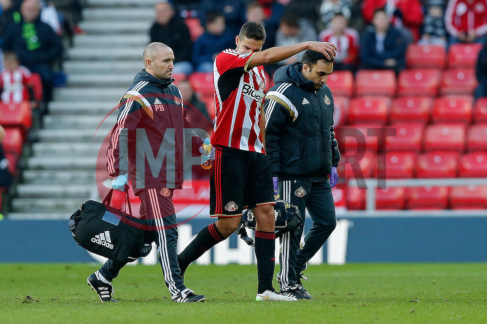 Jack Rodwell of Sunderland is helped off the pitch after taking a knock - Photo mandatory by-line: Rogan Thomson/JMP - 07966 386802 - 04/01/2015 - SPORT - FOOTBALL - Sunderland, England - Stadium of Light - Sunderland v Leeds United - FA Cup Third Round Proper.