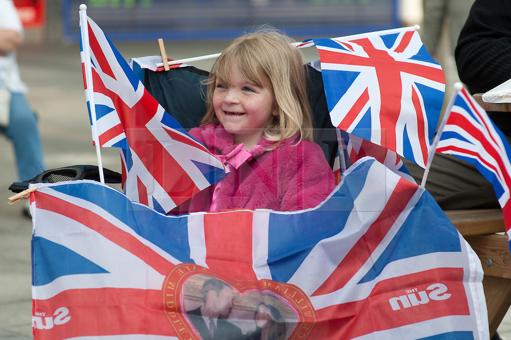 Plymouth, UK  29/04/2011. The Royal Wedding of HRH Prince William to Kate Middleton. A young girl covered in flags watches the wedding start on the Big Screen in Plymouth. Photo credit should read London News Pictures. Please see special instructions. © under license to London News Pictures