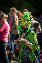 A woman wears a mask during the Penryn Festival in Cornwall
