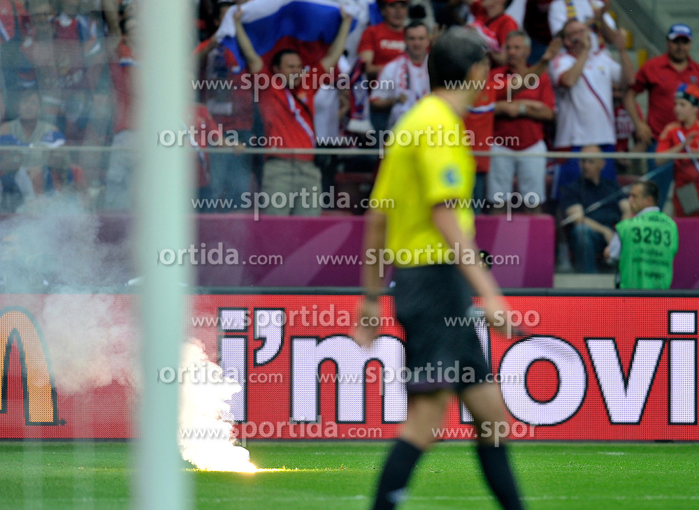 Fireworks on the grass during their the UEFA EURO 2012 Group A football match between Poland and Russia at National Stadium in Warsaw on June 12, 2012...Poland, Warsaw, June 12, 2012..Picture also available in RAW (NEF) or TIFF format on special request...For editorial use only. Any commercial or promotional use requires permission...Photo by © Adam Nurkiewicz / Mediasport