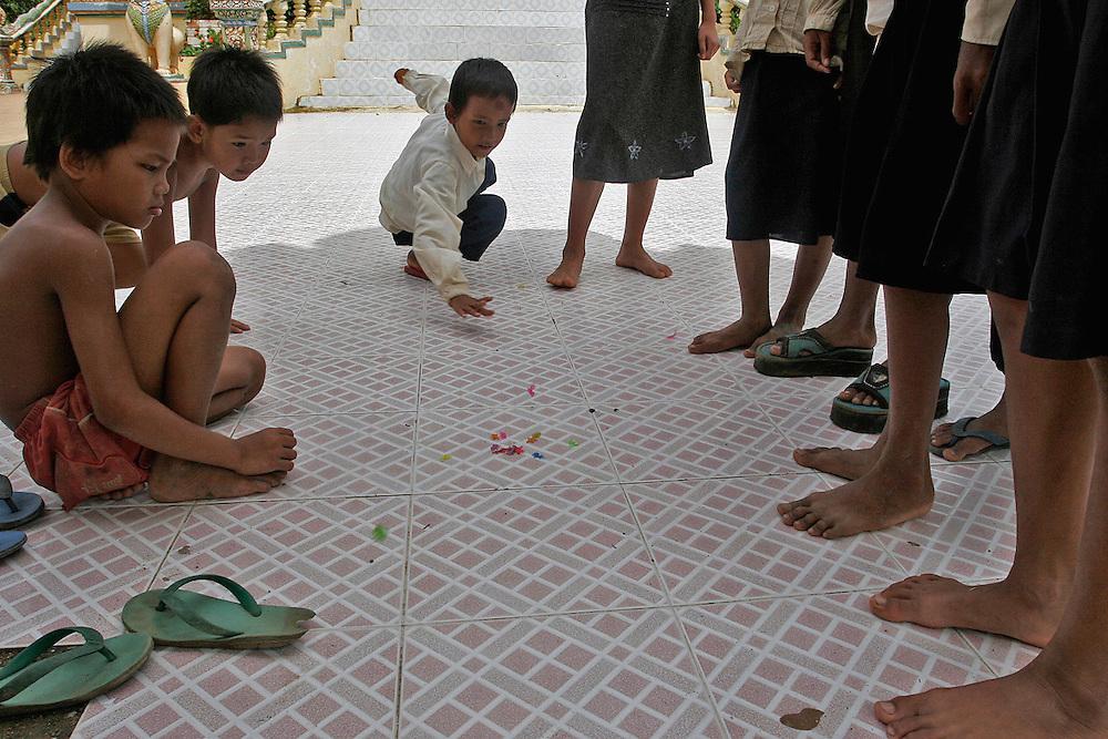 BATTAMBANG, CAMBODIA: Kids playing Su Bos Cao Su, a local kids game, in a small village near Battambang, Cambodia.