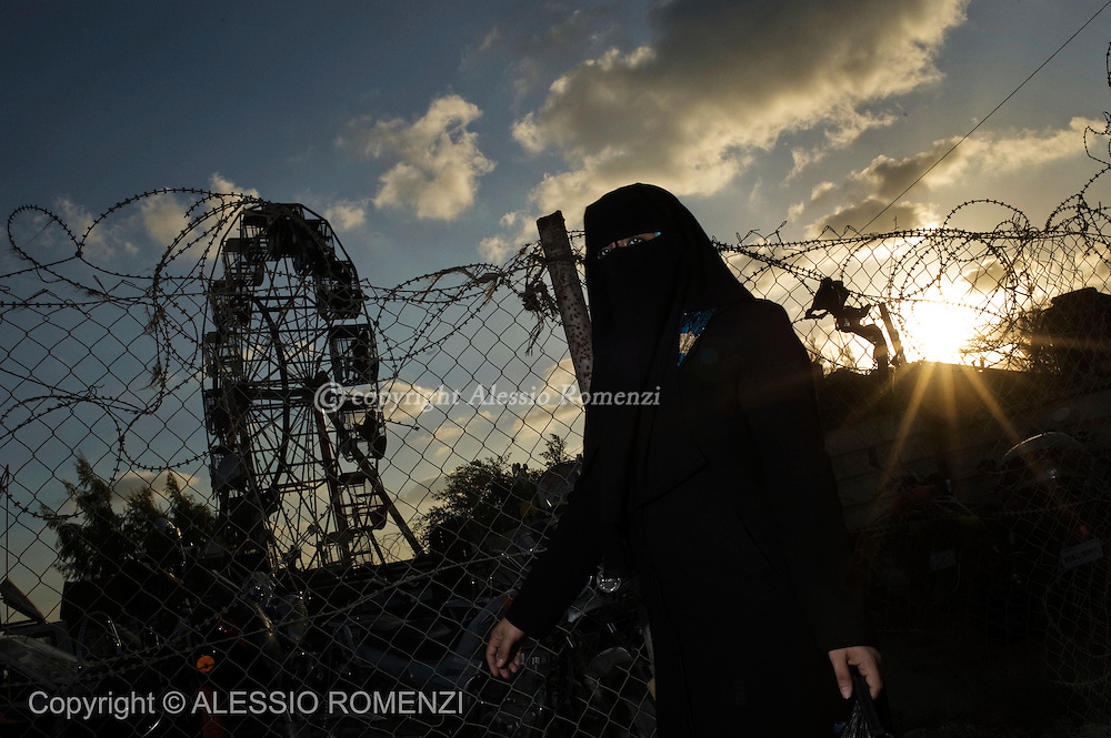 Amusement park on the outskirts of Gaza City  September 11, 2010  on the second day of the Eid al-Fitr, as Muslim families continue to celebrate the end of the holy fasting month of Ramadan.© ALESSIO ROMENZI