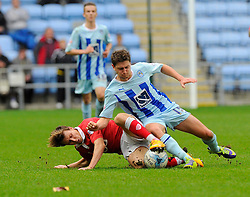 Bristol City's Luke Freeman battles for the ball with Coventry City's Shaun Miller  - Photo mandatory by-line: Joe Meredith/JMP - Mobile: 07966 386802 - 18/10/2014 - SPORT - Football - Coventry - Ricoh Arena - Bristol City v Coventry City - Sky Bet League One