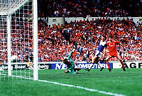 Ian Rush (Liverpool) scores Liverpool's 3rd goal past Kevin Radcliffe and goalkeeper Bobby Mimms. FA Cup Final 1986 @ Wembley. Liverpool v Everton. Credit : Colorsport/Andrew Cowie.