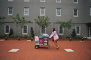 Incoming freshman Olivia Battle of Batesville, Miss. moves her belongings into a dorm as students began moving in at the University of Mississippi in Oxford, Miss. on Wednesday, August 17, 2011. Classes for the fall semester begin Monday, August 22, 2011. (AP Photo/Oxford Eagle, Bruce Newman)
