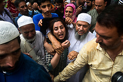 June 15, 2018 - Baramulla, J&K, India - A wife of  Shujaat Bukhari, veteran journalist and Editor-in-Chief of English daily 'Rising Kashmir,' cries during a funeral procession  in Kreeri, some 45kms from Srinagar, Indian administered Kashmir. Thousands of mourners attended Shujaat Bukhari's funeral in Baramulla today. Bukhari and his personal security officers (PSO's) were shot dead by unidentified gunmen at Press Colony in Srinagar on Thursday evening. (Credit Image: © Saqib Majeed/SOPA Images via ZUMA Wire)