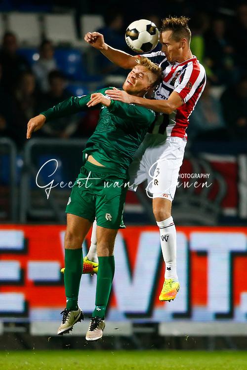 29-10-2016 VOETBAL:WILLEM II - FC GRONINGEN:TILBURG<br /> Freek Heerkens van Willem II in duel met Tom van Weert van FC Groningen  <br /> <br /> Foto: Geert van Erven