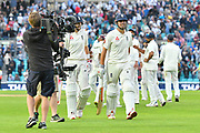Alastair Cook of England walks back to the pavilion with Joe Root of England to a standing ovation from the crowd after finishing the day unbeaten in his final test match innings during day 3 of the 5th test match of the International Test Match 2018 match between England and India at the Oval, London, United Kingdom on 9 September 2018.