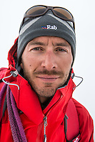 A portrait of a male mountaineer on a clody day in Mont Blanc Massif.