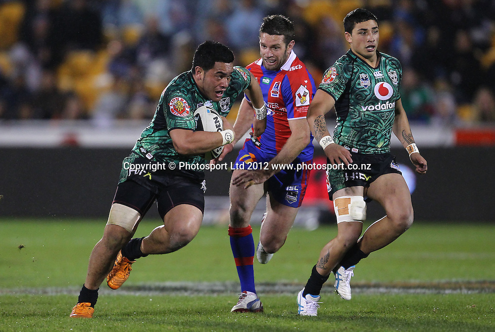 Konrad Hurrell of the Warriors makes a break during the NRL game, Vodafone Warriors v Newcastle Knights, Mt Smart Stadium, Auckland, Saturday 21st July 2012. Photo: Simon Watts /photosport.co.nz