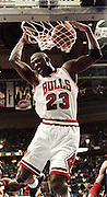 1997 NBA All-Star game -- Chicago's Michael Jordan slam dunks in the first half. Jordan got the first triple double in the history of the NBA All-Star game.