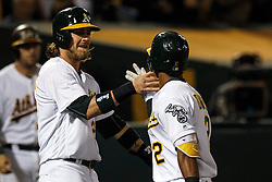OAKLAND, CA - JULY 15:  Khris Davis #2 of the Oakland Athletics is congratulated by Josh Reddick #22 after hitting a two run home run against the Toronto Blue Jays during the fifth inning at the Oakland Coliseum on July 15, 2016 in Oakland, California. (Photo by Jason O. Watson/Getty Images) *** Local Caption *** Khris Davis; Josh Reddick