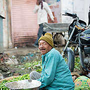 Portrait of Indian man selling vegetables at Jaipur market