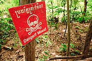 26 JUNE 2006 - SIEM REAP, CAMBODIA: A sign warning people to stay on a trail because of the presence of landmines in rural Cambodia. Nearly 30 years after the Khmer Rouge Cambodia is still awash in landmines. PHOTO BY JACK KURTZ