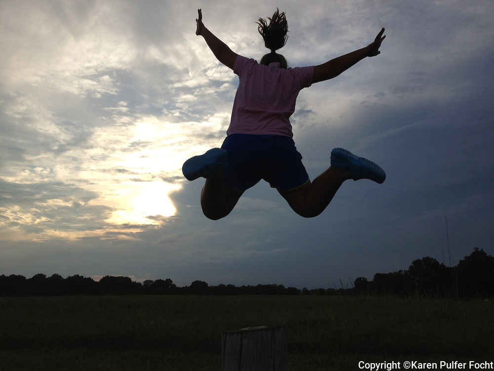 Elli Rose Focht leaps at Shelby Farms Park in Memphis, Tennessee. Shelby Farms is one of the largest urban parks in the country.
