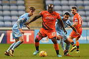 Wycombe Wanderers striker Adebayo Akinfenwa (20) holds the ball up 2-0 during the EFL Sky Bet League 2 match between Coventry City and Wycombe Wanderers at the Ricoh Arena, Coventry, England on 22 December 2017. Photo by Alan Franklin.