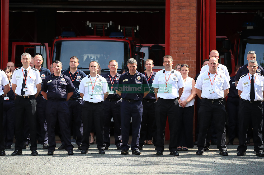 Firefighters and staff observe a minute's silence at Manchester Community Fire Station, in memory of those who died in the Grenfell Tower fire in west London last week.