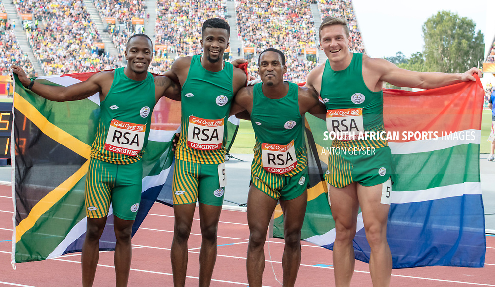 GOLD COAST, AUSTRALIA - APRIL 14:  Akina Simbine, Anaso Jobodwana ,Henricho Bruintjies and Emile Erasmus of South Africa in action 4x100m Men's relay during on day 10 of the Gold Coast 2018 Commonwealth Games at Carrara Athletics Stadium on April 14, 2018 in Gold Coast, Australia. (Photo by Anton Geyser)