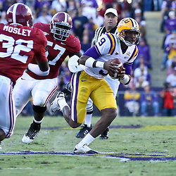 November 6, 2010; Baton Rouge, LA, USA;  LSU Tigers quarterback Jordan Jefferson (9) scrambles away from Alabama Crimson Tide linebacker C.J. Mosley (32) and defensive tackle Marcell Dareus (57) during the second half at Tiger Stadium. LSU defeated Alabama 24-21.  Mandatory Credit: Derick E. Hingle