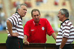 BANGKOK, THAILAND - Thailand. Thursday, July 24, 2003: Liverpool's manager Gerard Houllier (c) with Chief-Executive Rick Parry (l) and Chairman David Moores (r) pictured before a preseason friendly match against Thailand at the Rajamangala National Stadium. (Pic by David Rawcliffe/Propaganda)