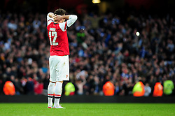 Arsenal's Oliver Giroud cuts a dejected figure at the end of the game in front of the Blackburn Rovers support - Photo mandatory by-line: Dougie Allward/JMP - Tel: Mobile: 07966 386802 16/02/2013 - SPORT - FOOTBALL - Emirates Stadium - London -  Arsenal V Blackburn Rovers - FA Cup - Fifth Round