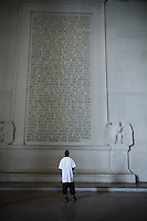 A man reads the Gettysburg Address engraved in stone on the wall at the Lincoln Memorial, in Washington, DC, on January 21, 2006.