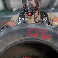 Chris Jenkins, Deputy Fire Chief with the Saltillo Fire Department, flips over an oversized tire as he trains at the department on Friday afternoon.