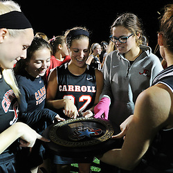 TOM KELLY IV &mdash; DAILY TIMES<br /> Carroll players celebrate their win over O'Hara with the championship plaque following the Philadelphia Catholic League Championship Field Hockey match between Archbishop Carroll and Cardinal O'Hara which was held Thursday night October 30, 2014 at Neumann University.