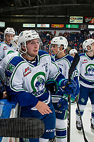 KELOWNA, BC - OCTOBER 16:  Ethan Regnier #18 of the Swift Current Broncos stands at the bench against the Kelowna Rockets at Prospera Place on October 16, 2019 in Kelowna, Canada. (Photo by Marissa Baecker/Shoot the Breeze)